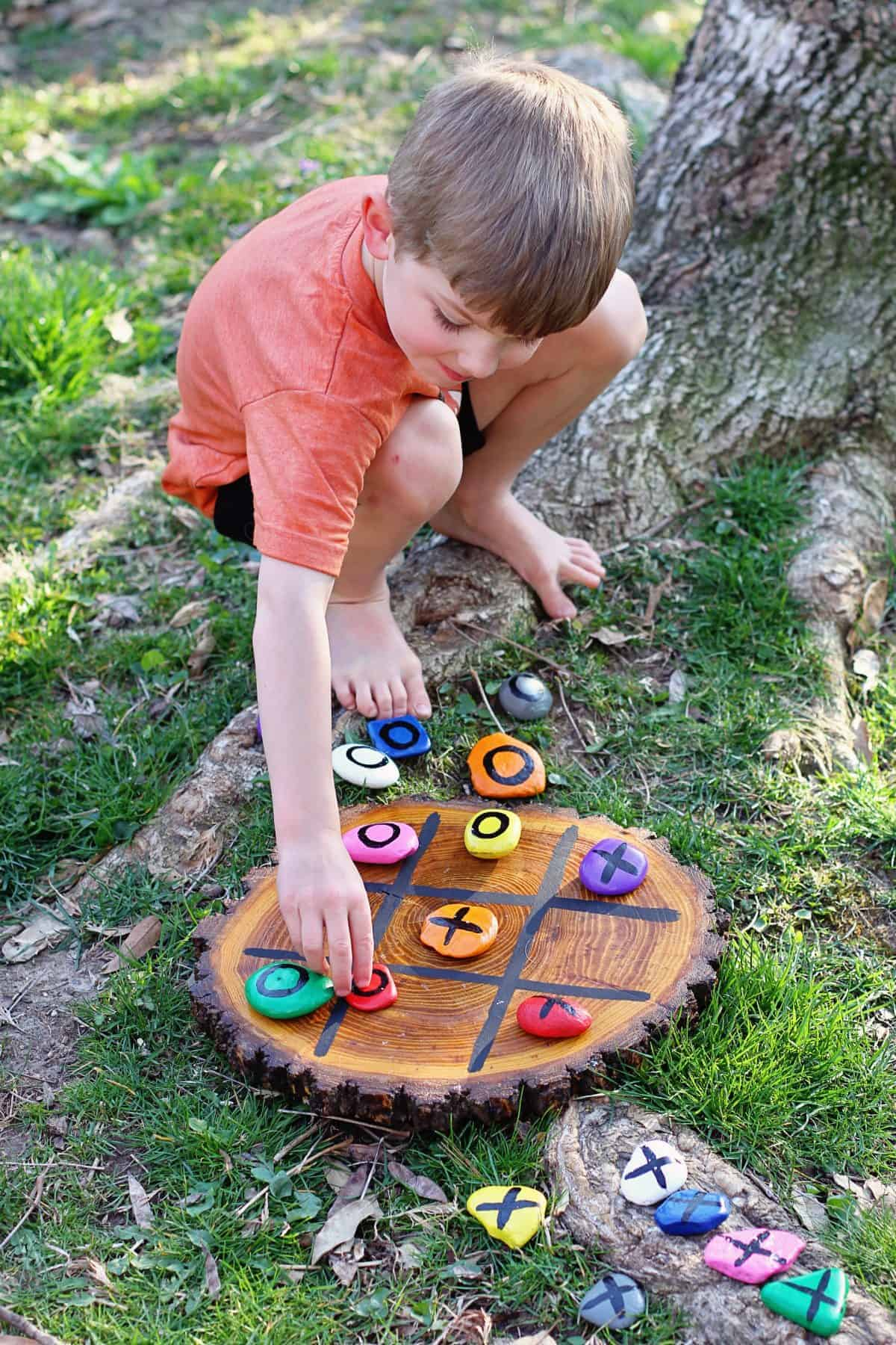 kids playing outdoor tic tac toe