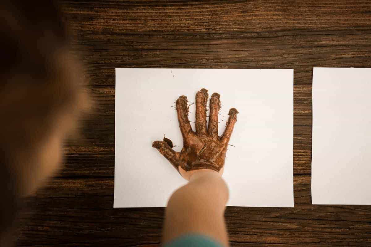 Muddy Hand Print - mud art projects for kids